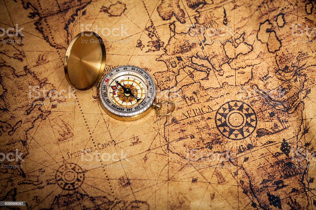 Old golden compass on map stock photo