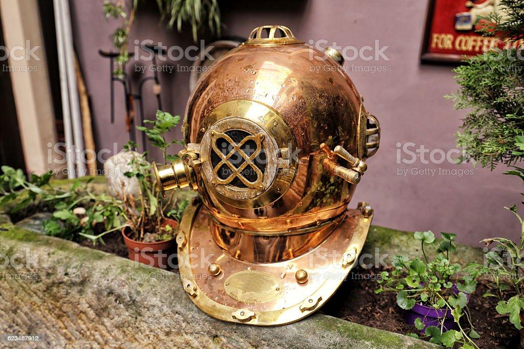 Old golden helmet for deep diving stock photo