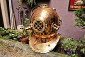 Old golden helmet for deep diving