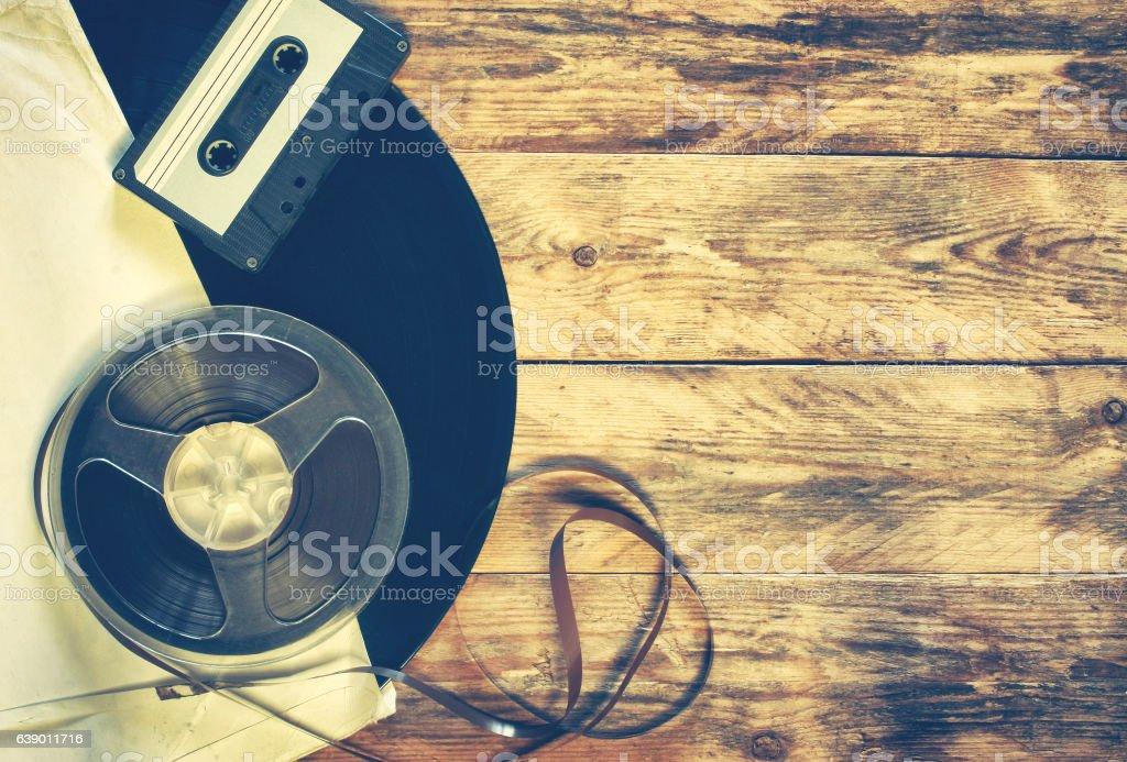 old gramophone record, audio cassette, tape bobbin stock photo
