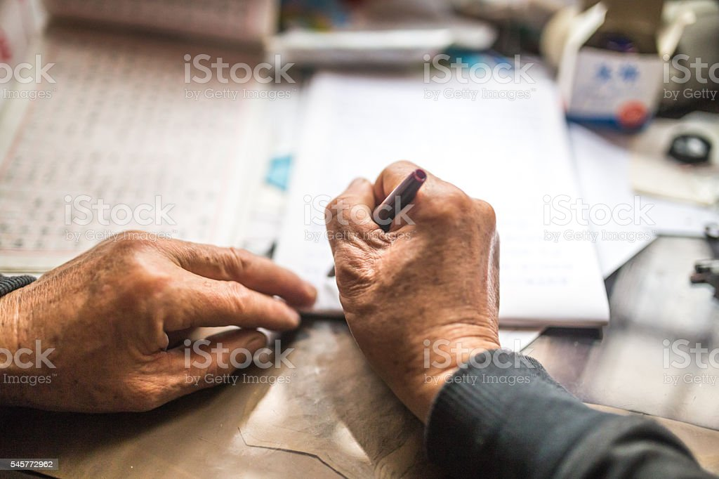 Old grandfather writing letters stock photo