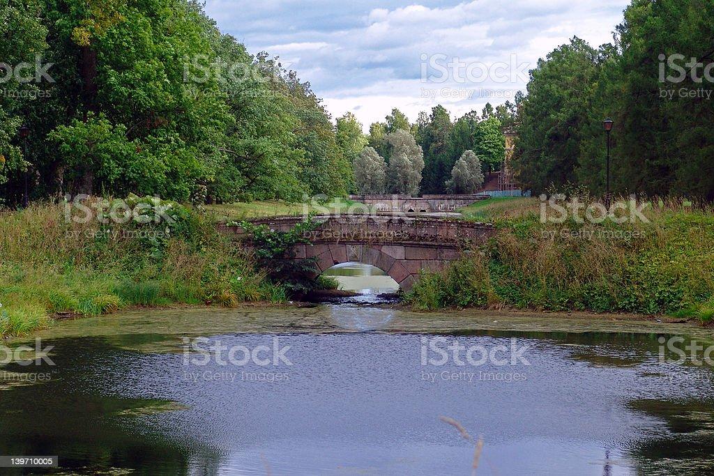 Old Granite Bridge in the park royalty-free stock photo
