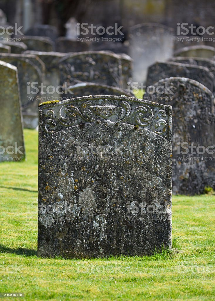 Old Grave head stone stock photo