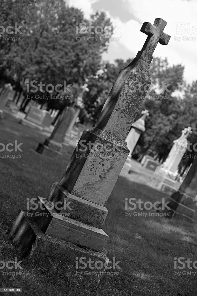 Old gravestone with cross b/w royalty-free stock photo