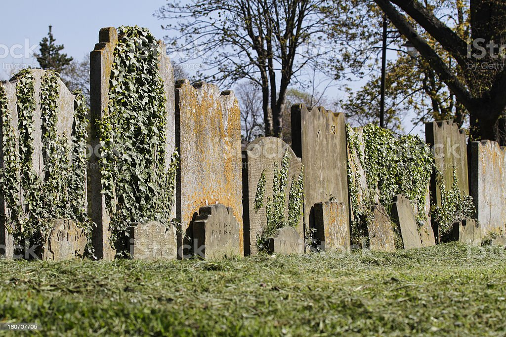 Old blank gravestones together in churchyard royalty-free stock photo