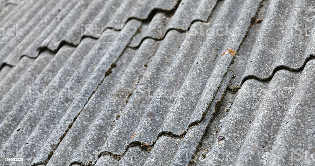 Old gray corrugated fibre cement roofing stock photo