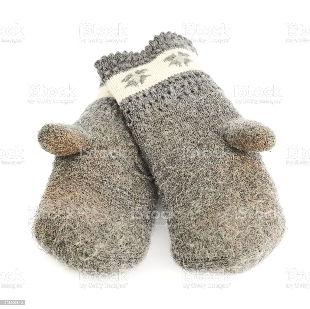 Old gray frayed mitten isolated stock photo