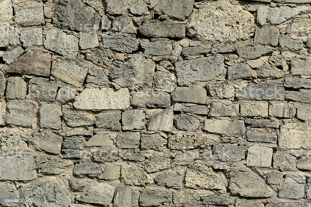 old gray stone masonry stock photo