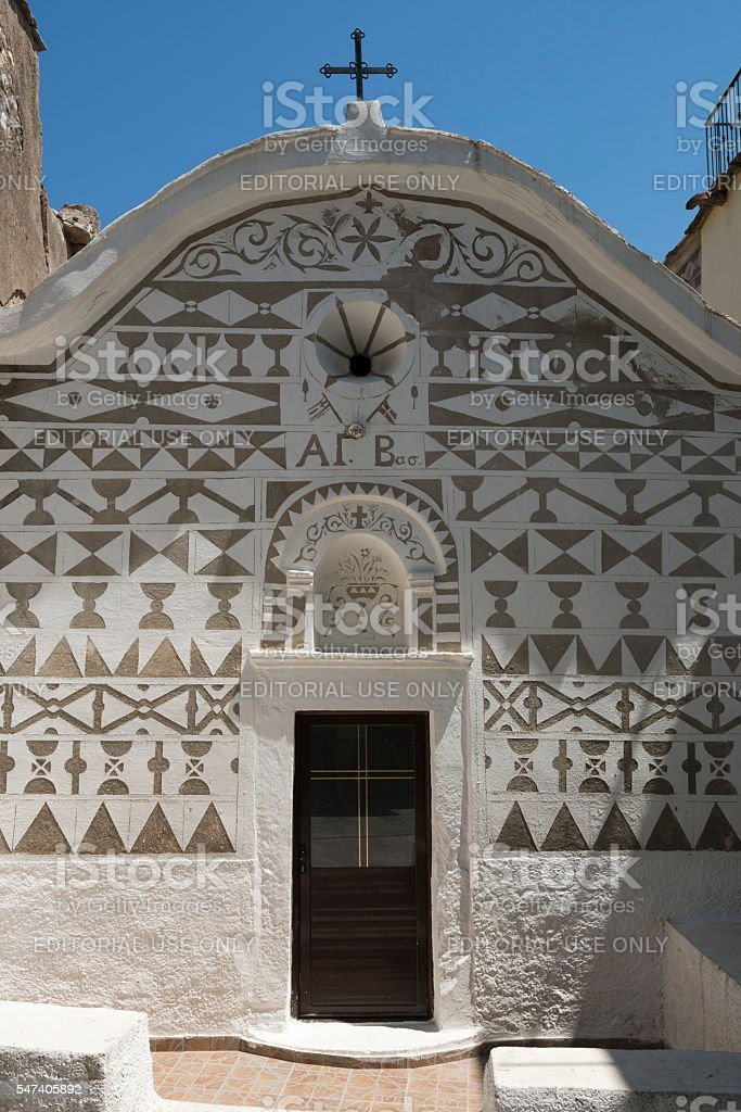 Old Greek Island church with decorated facade stock photo
