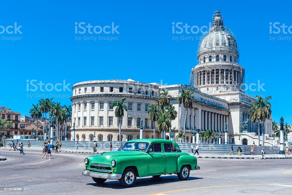 Old Green American car on Havana street stock photo
