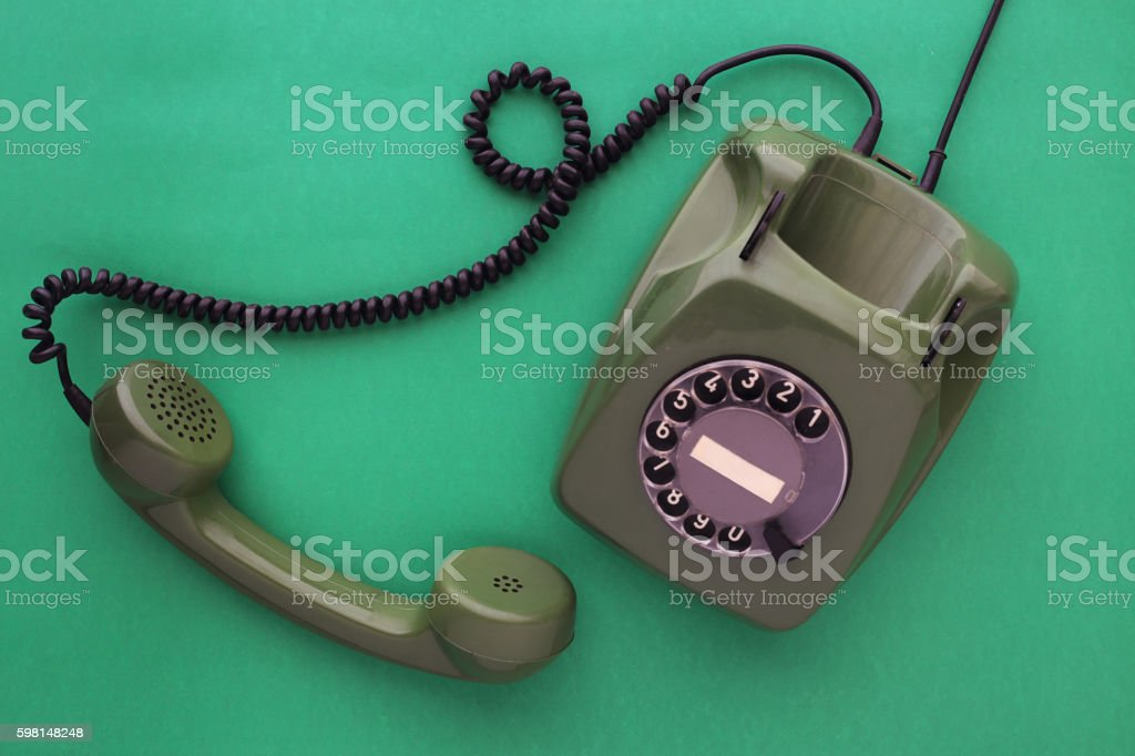 Old green bakelite telephone stock photo