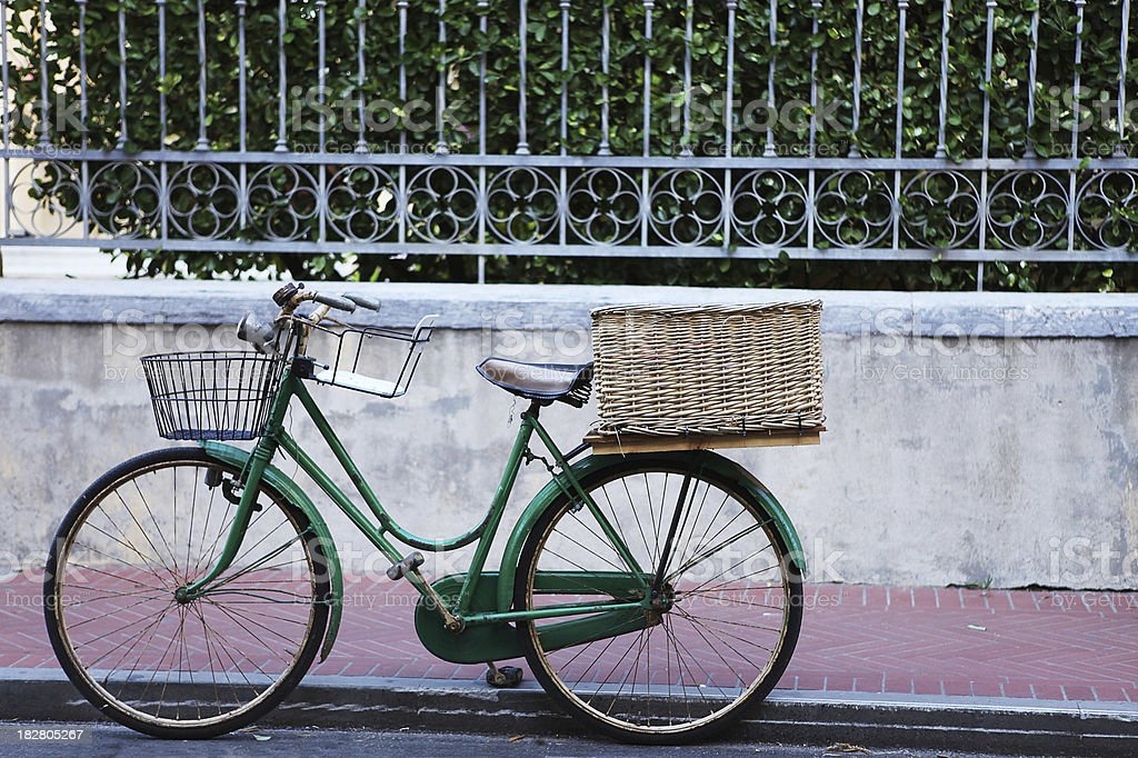 Old green bike by a wall in Levanto, Italy royalty-free stock photo