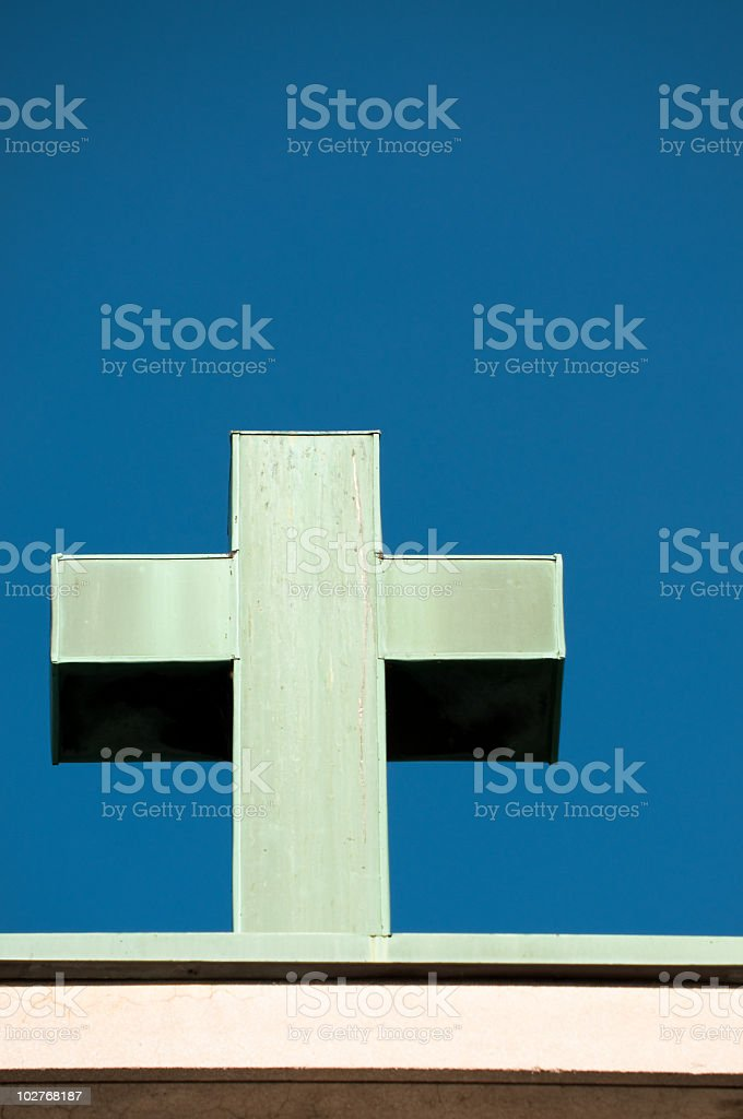Old green copper cross stock photo