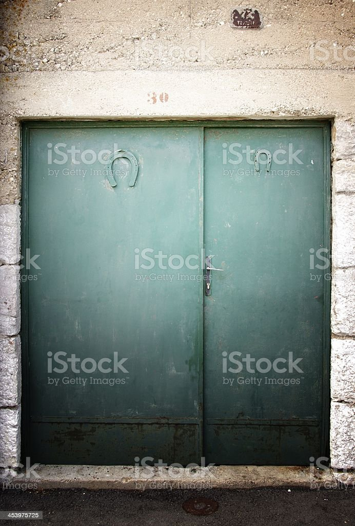 Old green door with lucky horseshoe royalty-free stock photo
