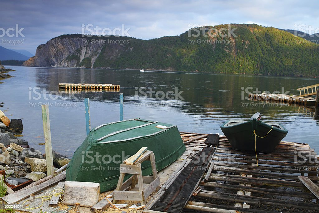 Old green fishing boat stock photo
