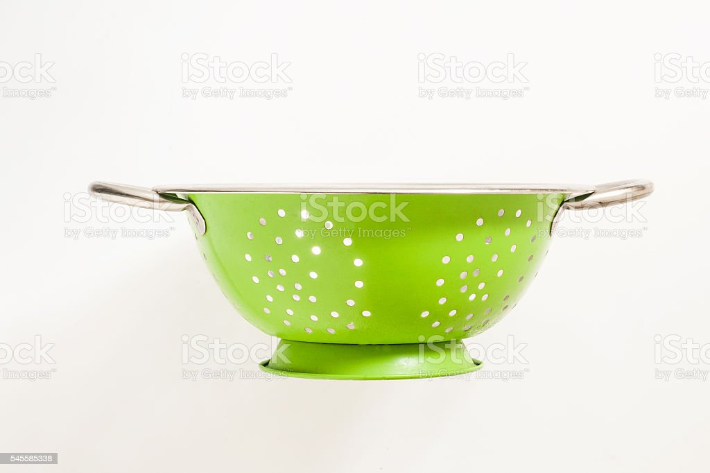 Old green metal colander sieve stock photo