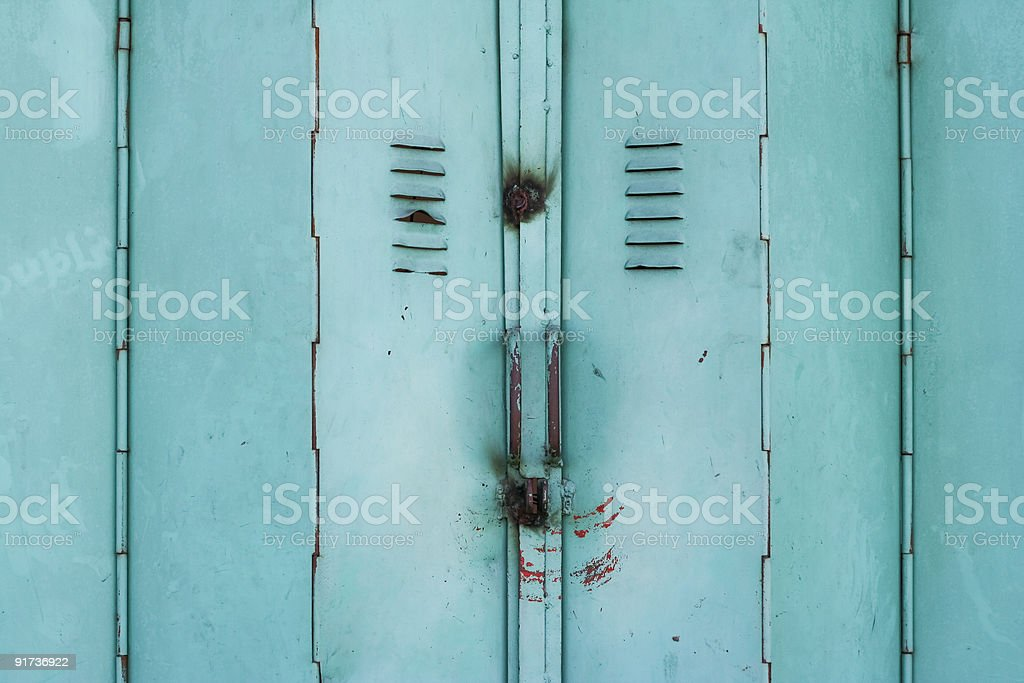 old green metal folding doors background royalty-free stock photo