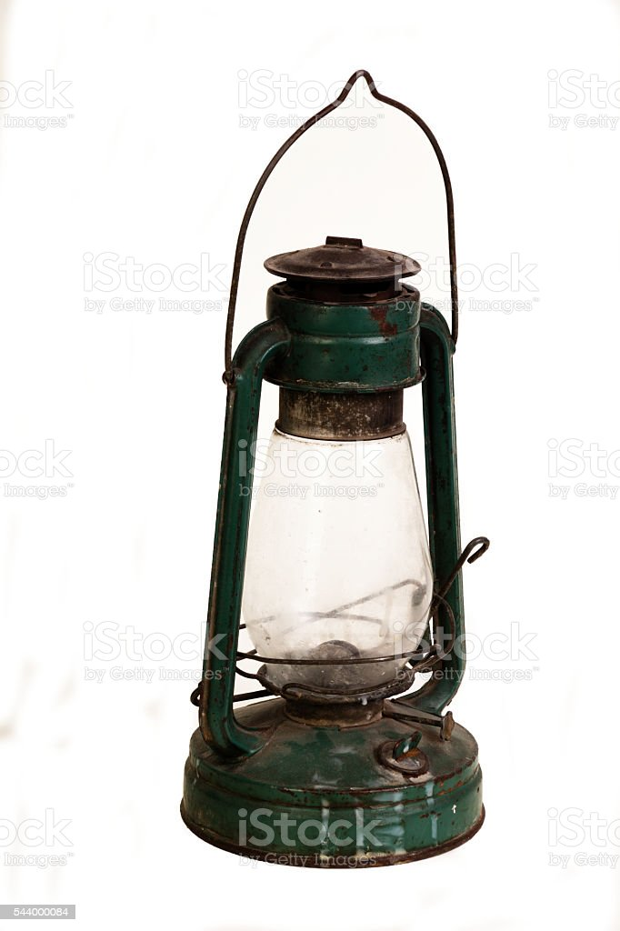 Old green rusty lantern isolated on white stock photo