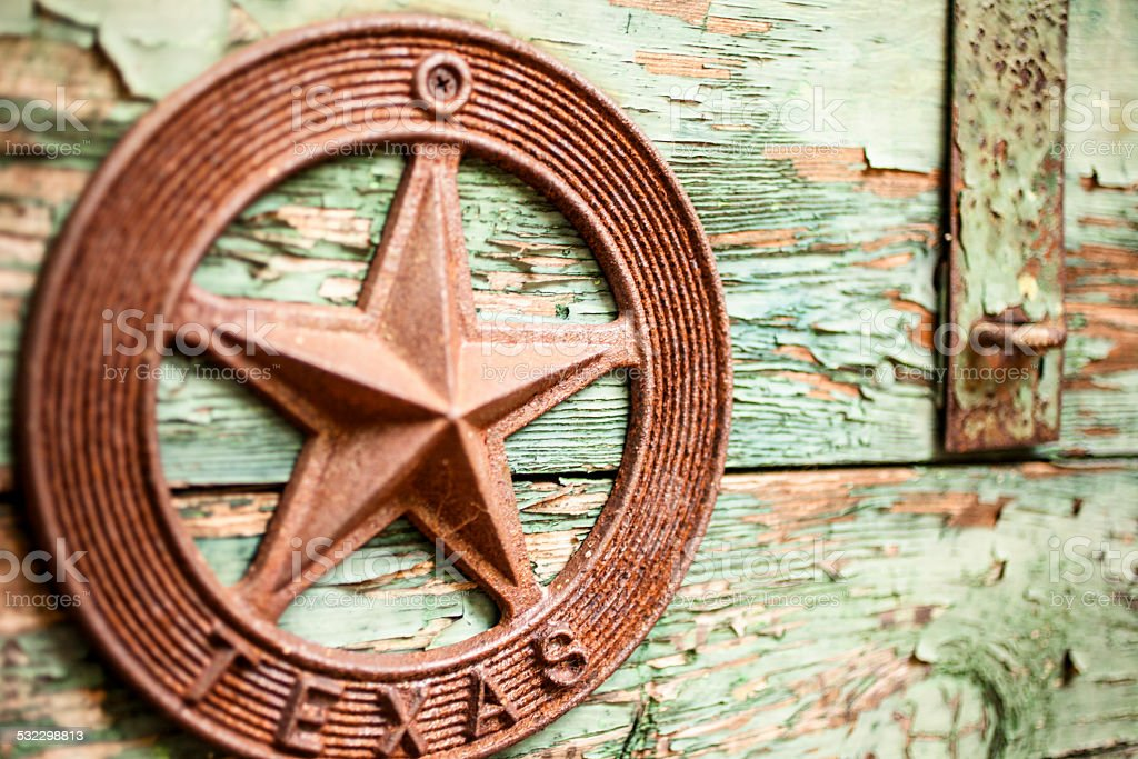 Old, green wooden chest with iron Texas star. Weathered, rustic. stock photo