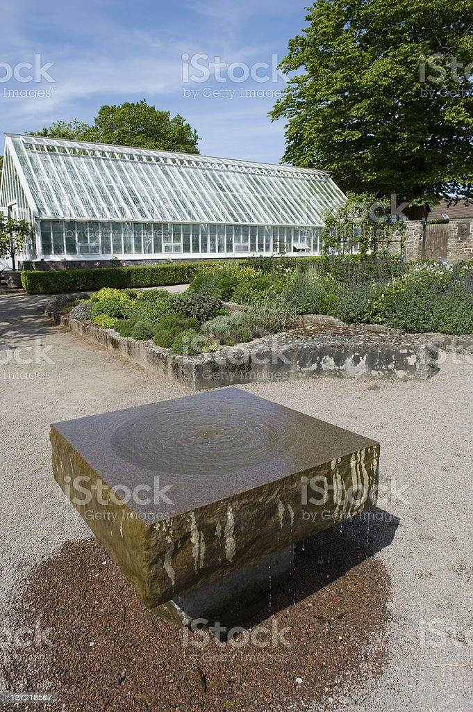 Old greenhouse and fountain royalty-free stock photo