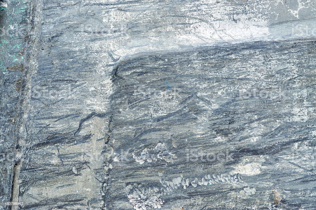 Old grey rough and scratched metal surface stock photo