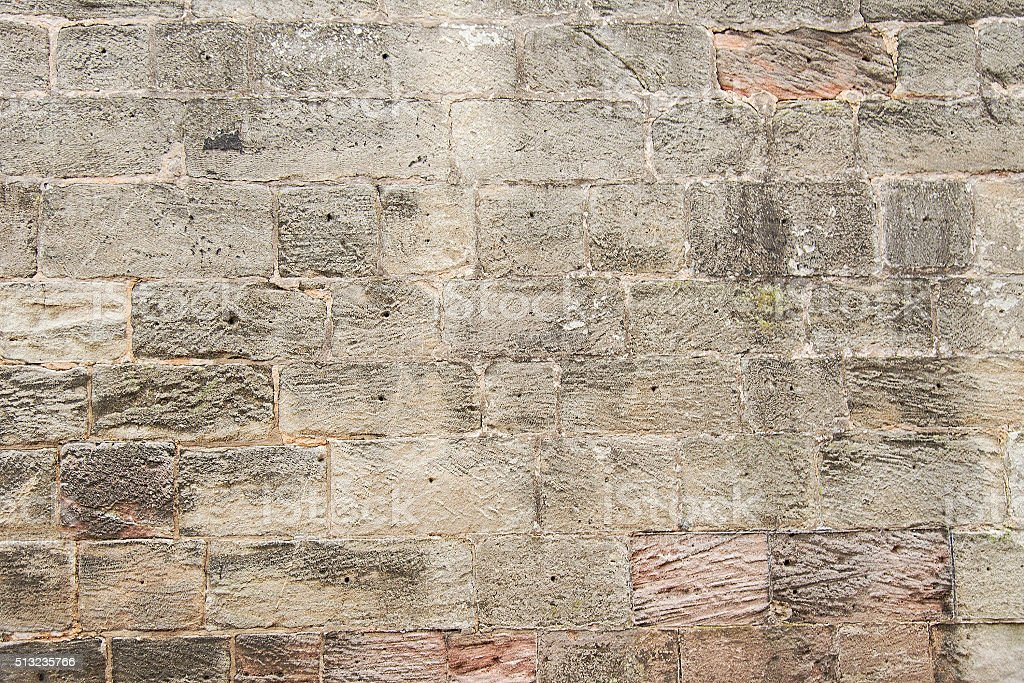 Old grey stone wall background texture stock photo