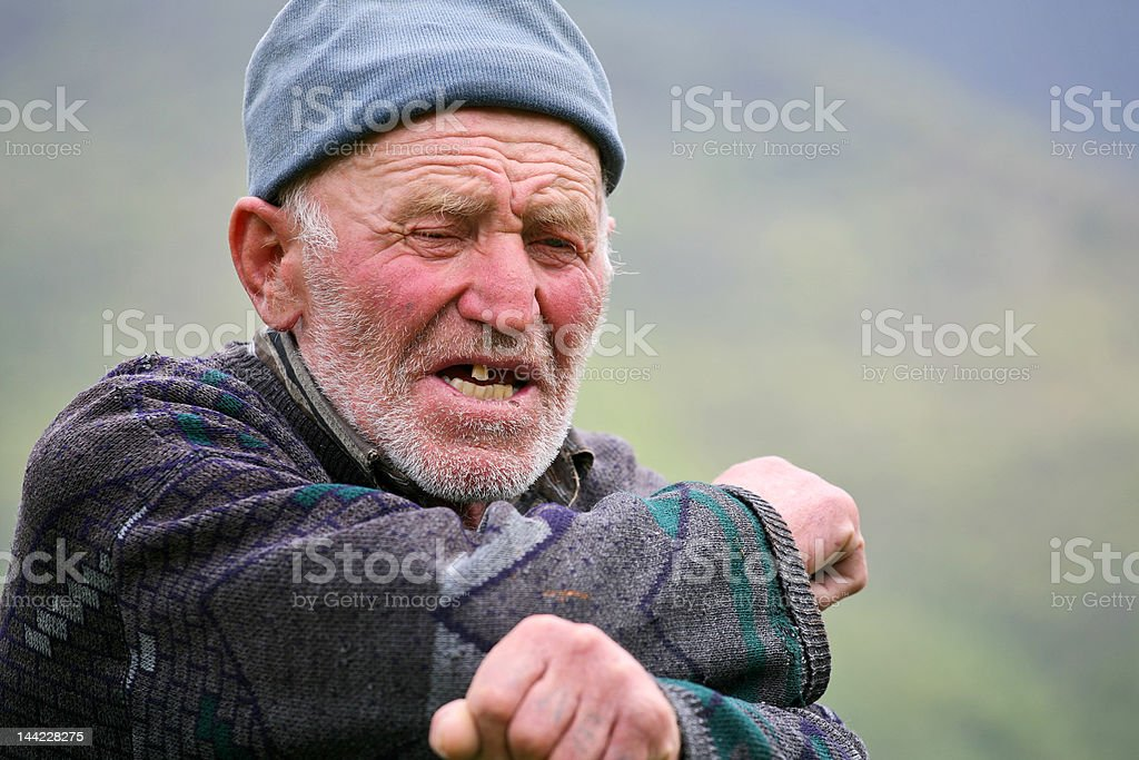 Old grey-haired man with mountains background royalty-free stock photo