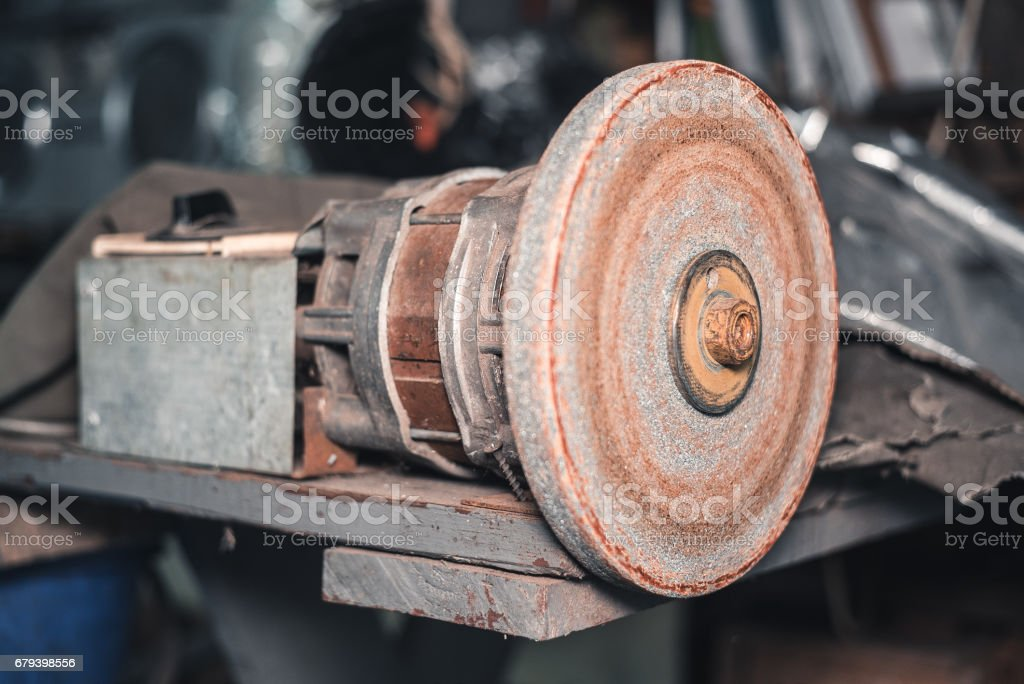 old grinder in an abandoned room stock photo