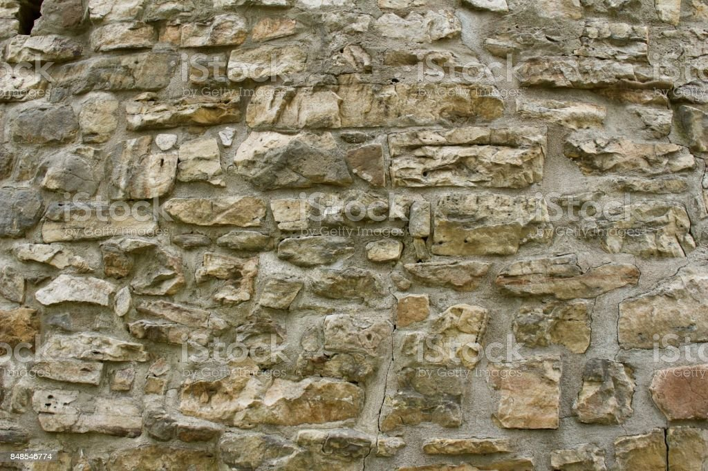 Old gristmill stone wall background stock photo