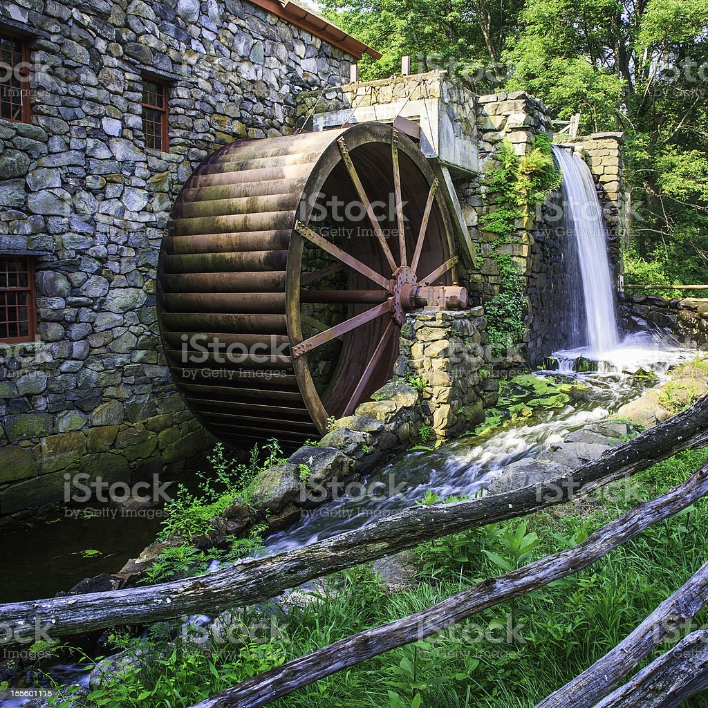 old gristmill waterwheel stock photo