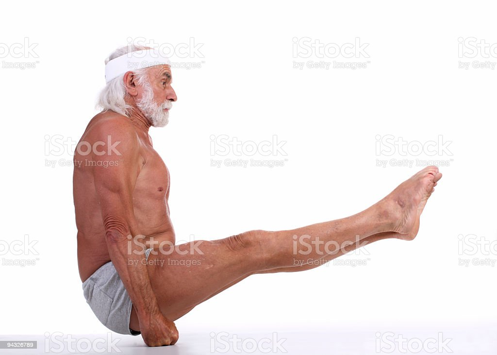 Old grizzled man standing on hands. stock photo