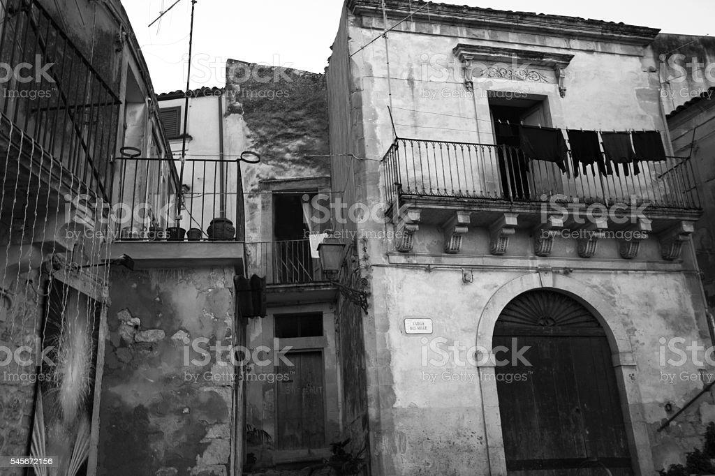Old Grotty Sicilian Neighborhood, Hanging Black Laundry (B&W) stock photo