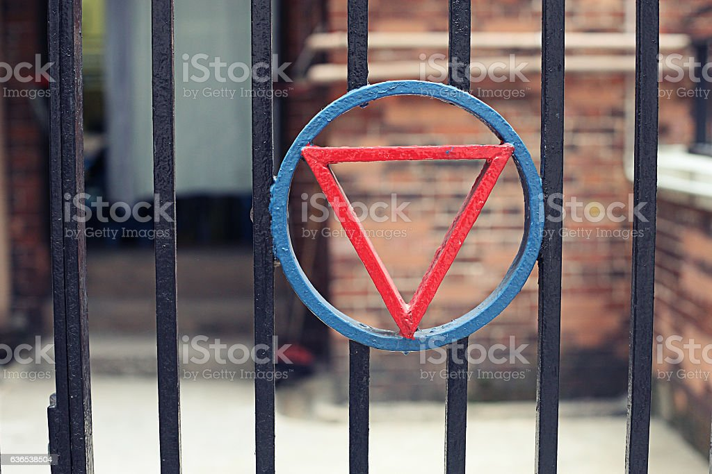 Old grunge building structure with metal fence stock photo