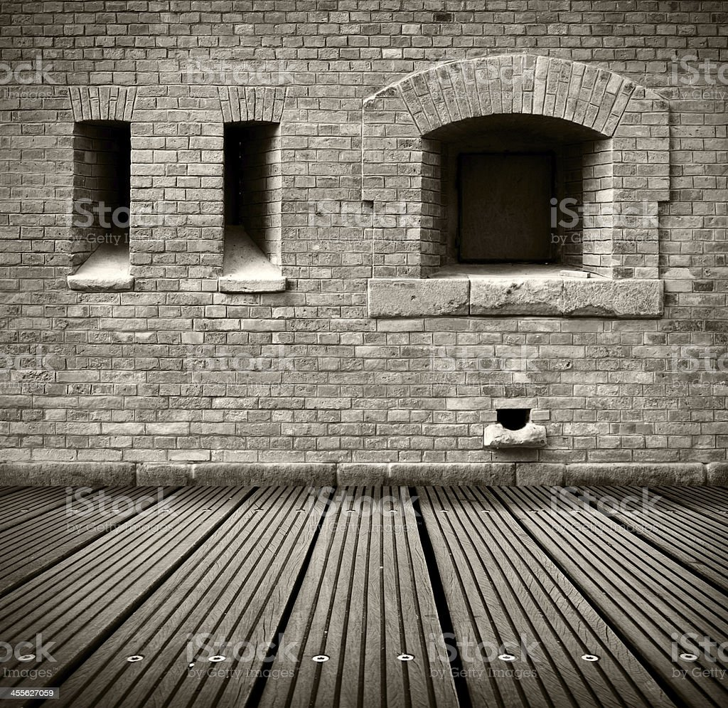 old grunge interior with brick wall and wooden floor. royalty-free stock photo