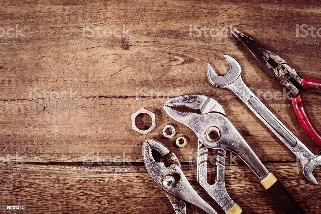old & grunge set of hand tools on wood stock photo