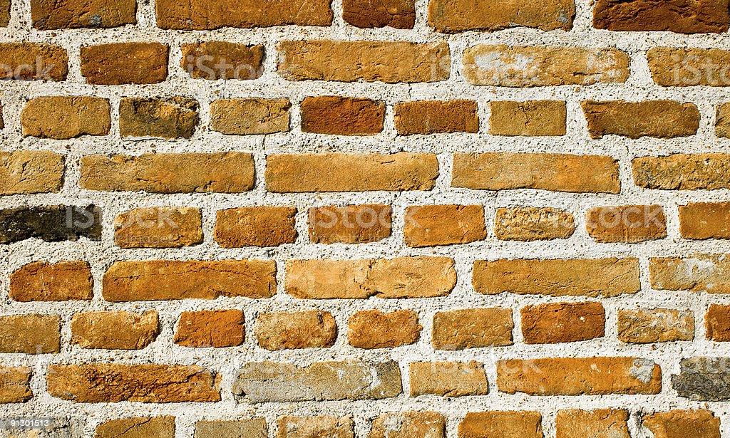 Old grunge textured brick wall stock photo