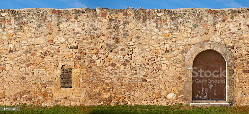 Old grunge wall. Sky and grass royalty-free stock photo