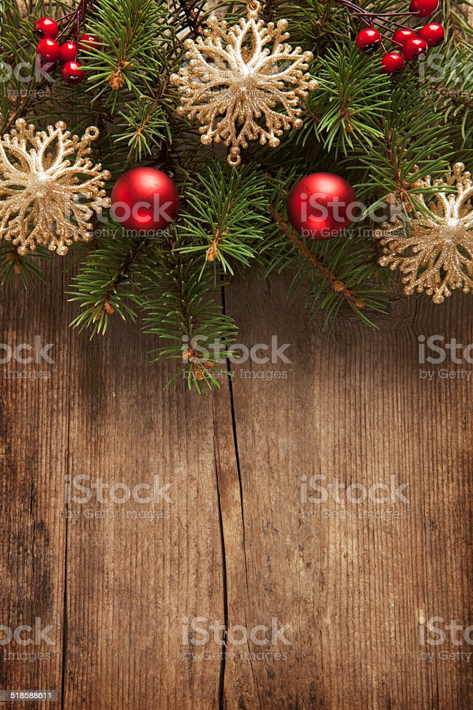 Old grunge wooden board with Christmas border. stock photo