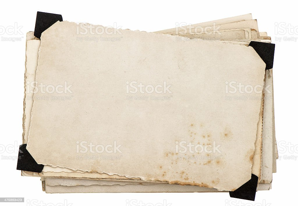 Old grungy paper with black plastic corners stock photo