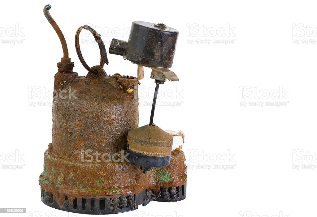 Old grungy rusted sump pump stock photo
