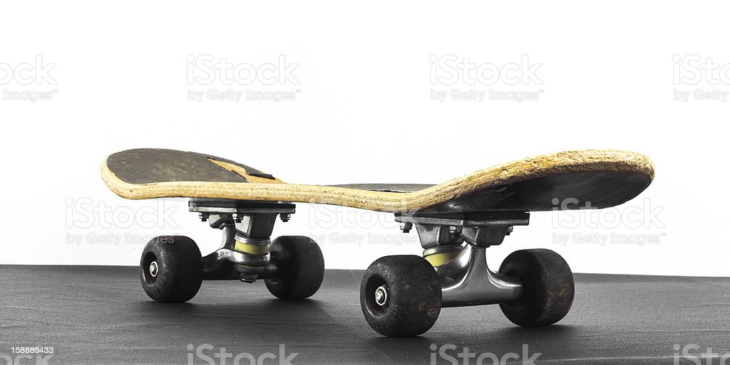 Old grungy skateboard royalty-free stock photo