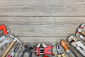 old grungy tool set on gray wooden boards background