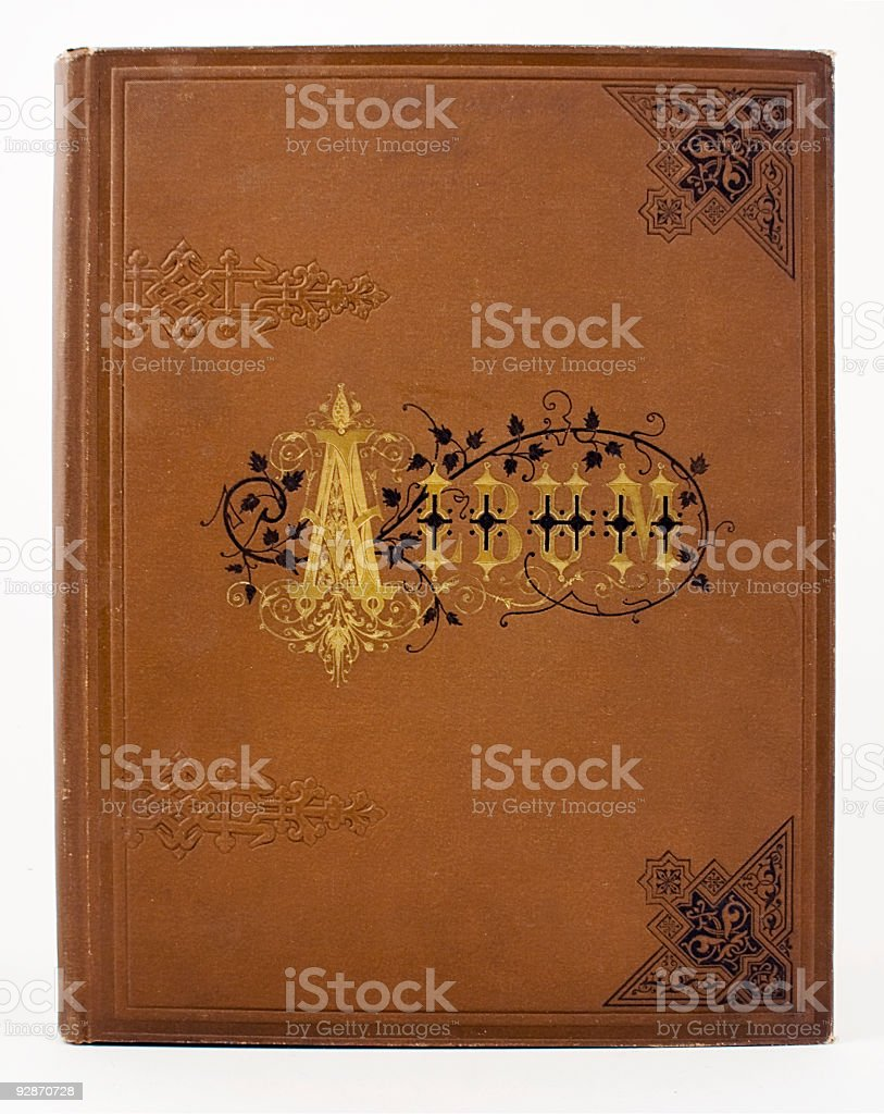 Old  grungy Victorian  scrap album on white background. stock photo