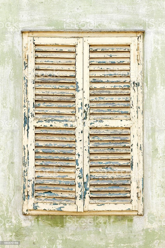 Old grungy window shutters royalty-free stock photo