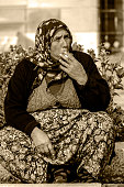 Old gypsy woman smoking sigarette