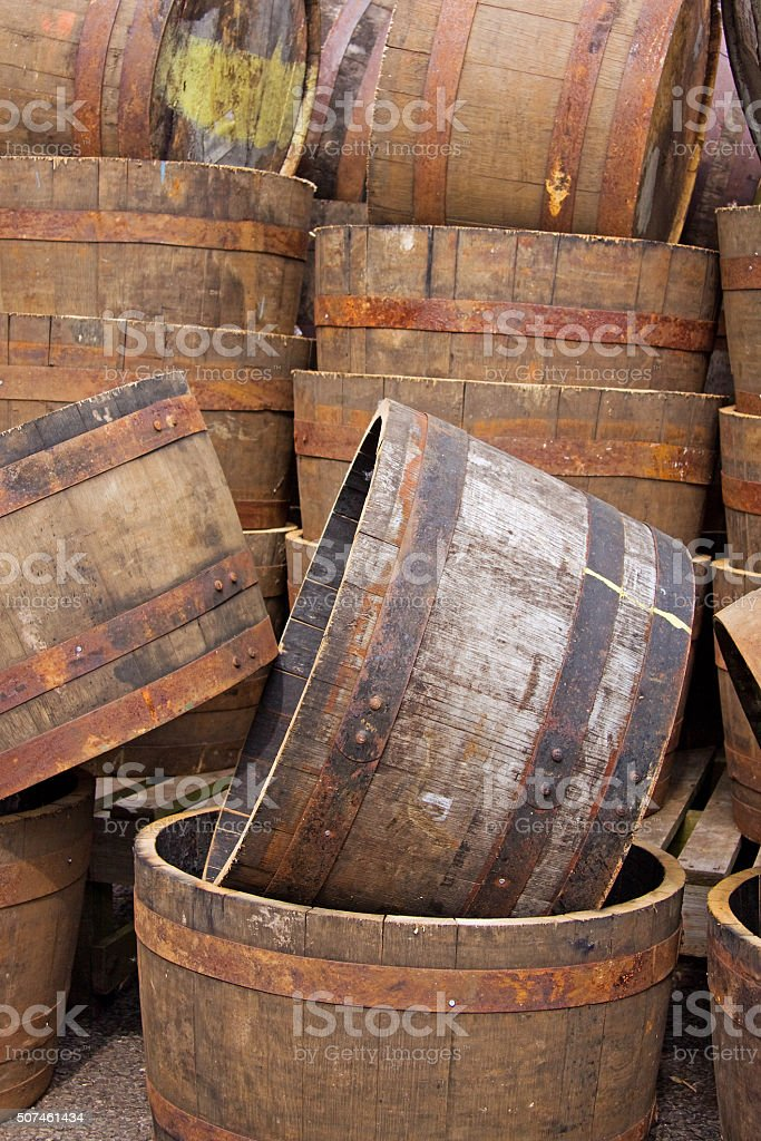 Old half barrels stacked for sale in a market, UK stock photo