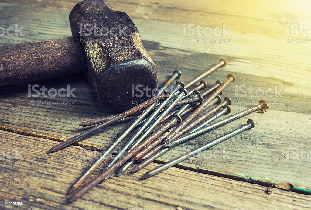 Old hammer and nails stock photo