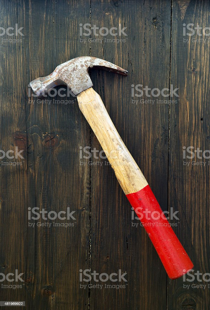 Old hammer on wooden background stock photo
