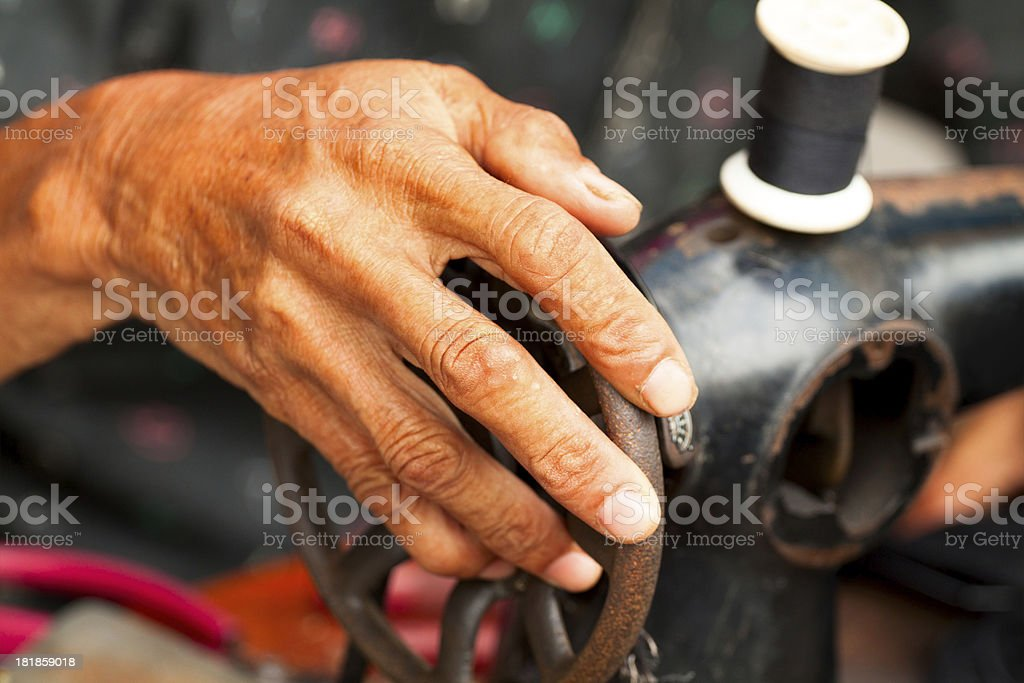 Old hand and sewing machine royalty-free stock photo