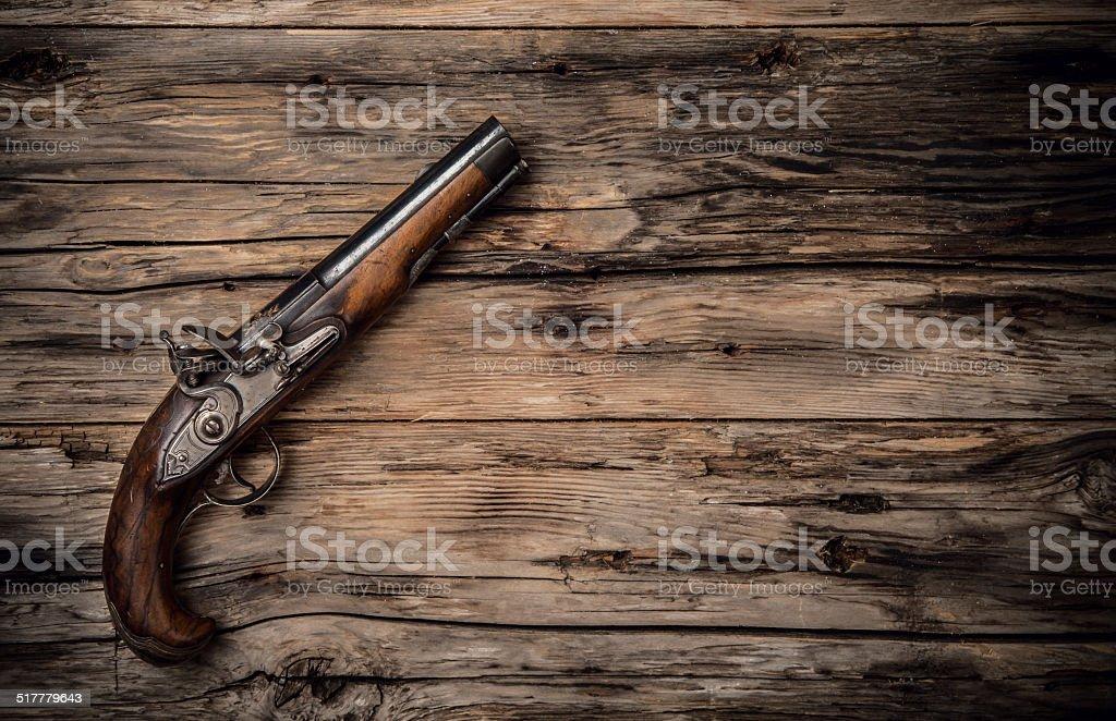 Old hand gun on wod stock photo